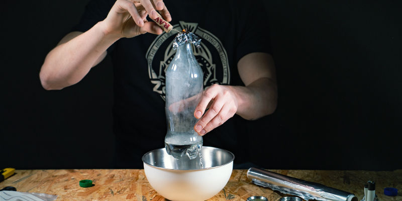 Waterfall gravity bong: Once the water has dropped beneath the hole, pull the aluminum foil off.