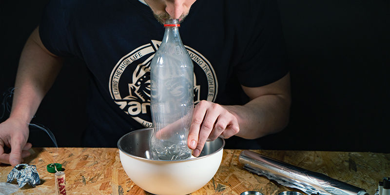 Waterfall gravity bong: Put your mouth over the top and breathe in hard.