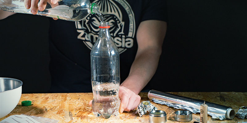 Waterfall gravity bong: Fill with water and cover the rush hole
