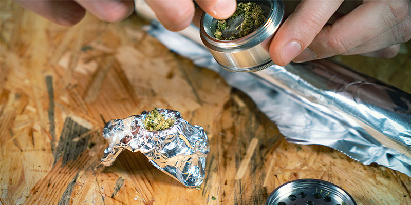 Waterfall gravity bong: remove the bottle cap and wrap tin foil over the top to make a bowl